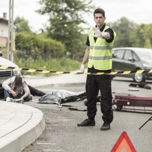 Policeman at road accident scene