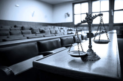 Symbol of law and justice in the empty courtroom, law and justice concept, blue tone