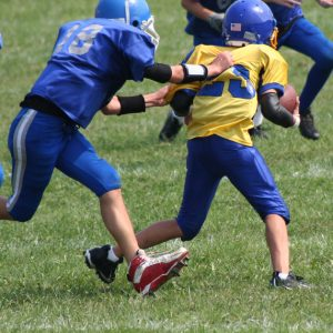 kids playing football; concussion risks