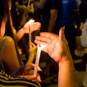 Group of people holding candle vigil