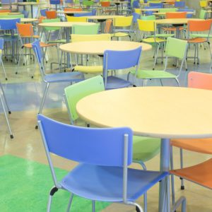 Tables in a big colorful school cafeteria