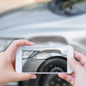 using smartphone take photo car crash accident of the damage to the car for accident insurance