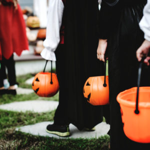 Little children in Halloween costumes trick or treating